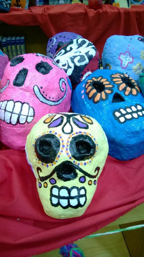 These decorative skulls represent the Day of the Dead.