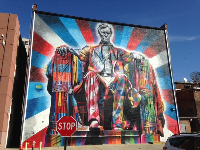 This is a photo of the Lincoln Mural painted by Eduardo Kobra. It is on the back of The Kentucky Theater building, and it can be seen from Vine Street in downtown Lexington.