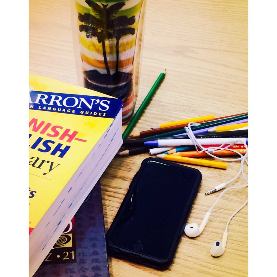 A phone, headphones, and pencils are just some of the most important high school essentials.