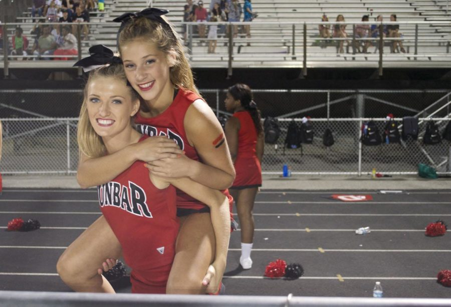 Abby Kelley and Christina Thorson pose for a picture during halftime.