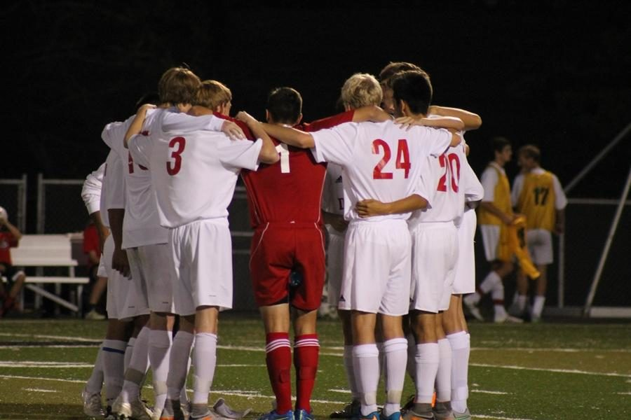 The team huddles before the game.