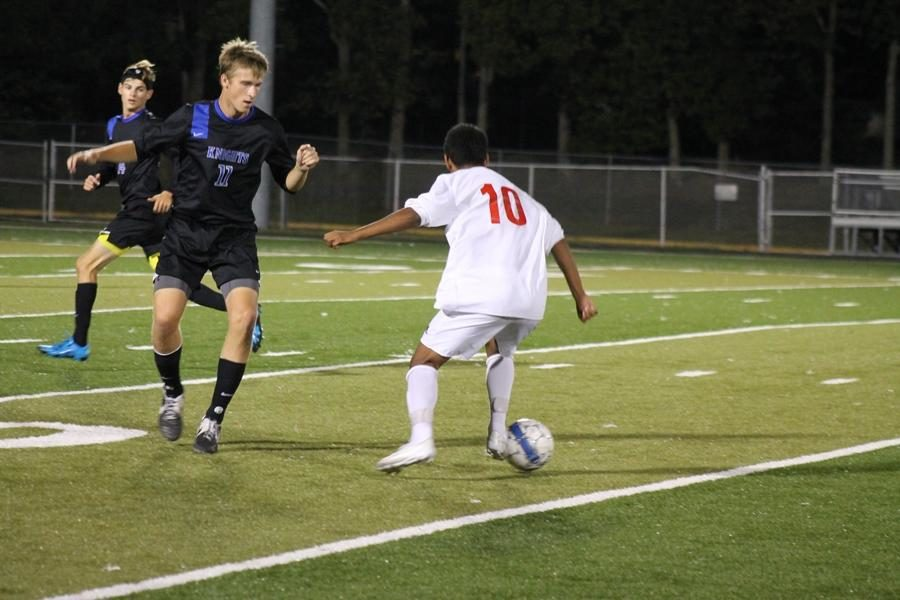 Number 10, Ricky Clemente, moves past opposing players.