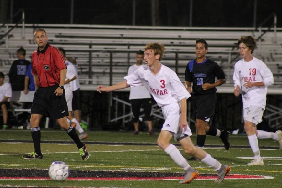 Number 3, Caleb Norris, moves the ball down the field.