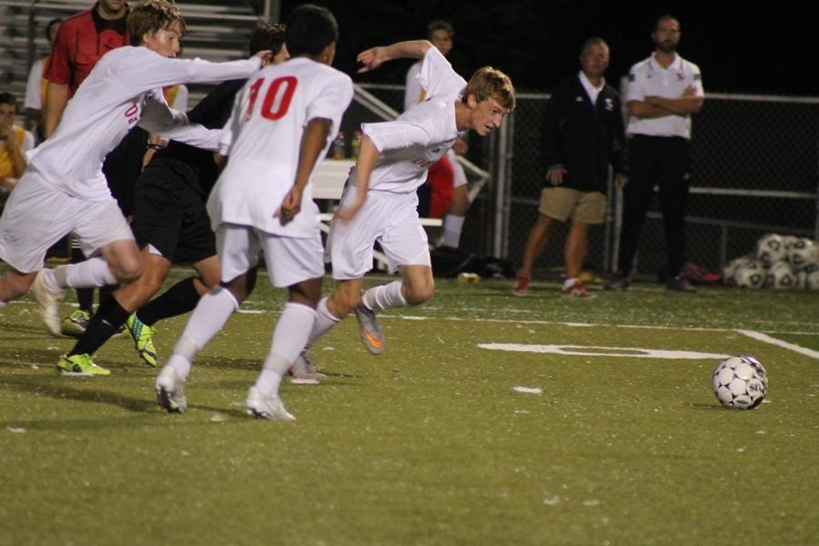 Dunbar players run to beat Lexington Catholic player to the ball.
