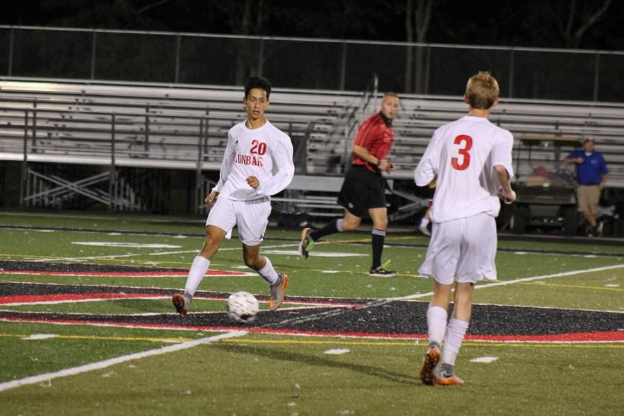 Number 20, Javier Delgado, looks for a pass to number 3, Caleb Norris.