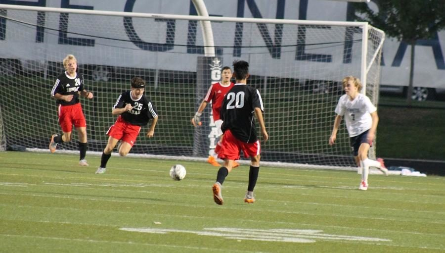 (From left to right) Drew Slone, Jack Sheroan, and Javier Delgado keep the ball from their goal.