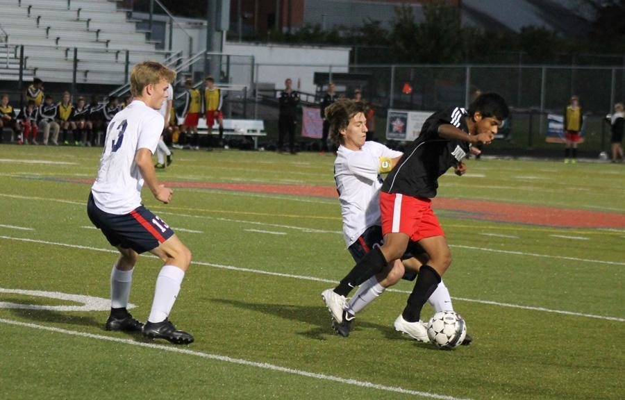 Number 10, Ricky Clemente, fights for the ball against Lafayette players.