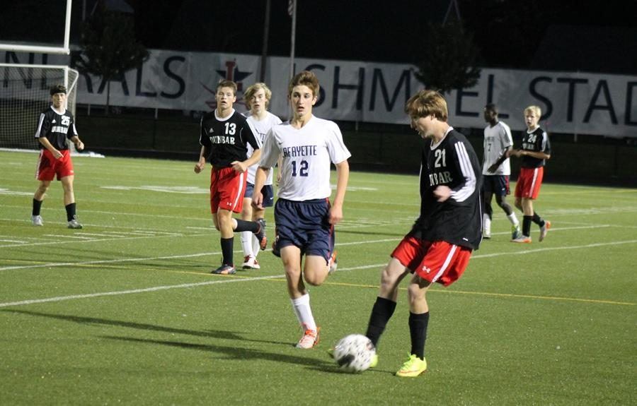 Number 21, Patrick Irving, moves the ball down the field.