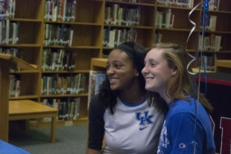 Leah Edmond and Madison Winstead smile after signing their National Letters of Intent.
