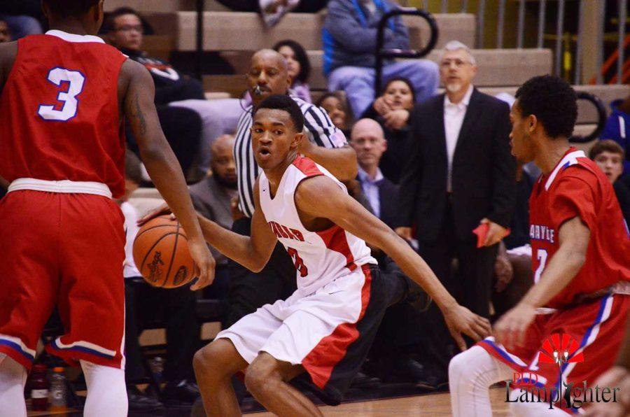Senior Jordan Lewis prepares to pass the ball.