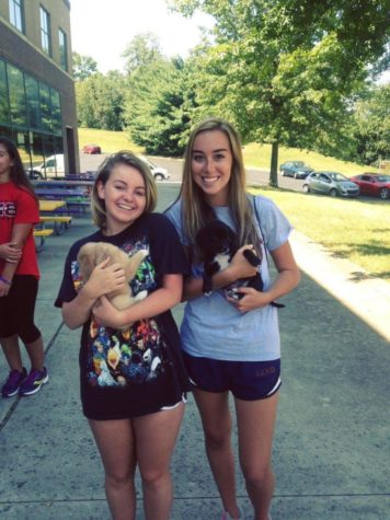 Pam Straits and I pose with puppies while volunteering at Dunbar's memorial garden.