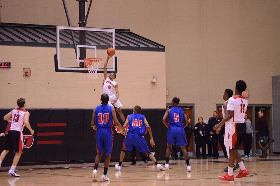 Number 0, Jordan Lewis, shoots a lay-up.