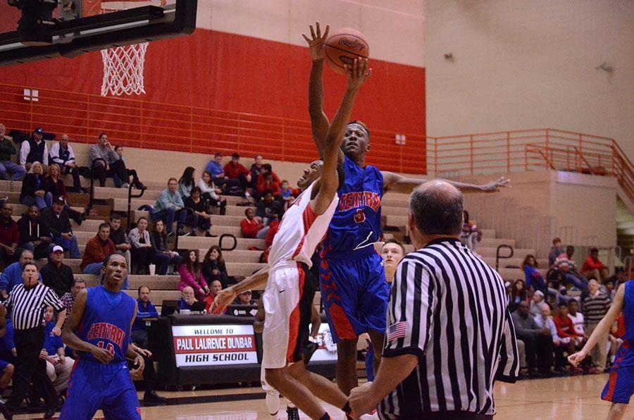 Jordan Lewis shoots against opposing player.