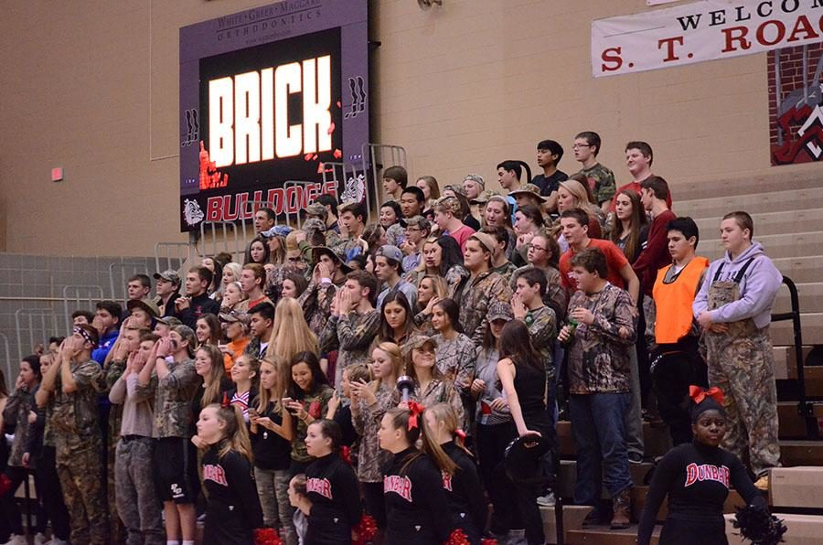 The student section cheering while opposing team shoots a free throw.