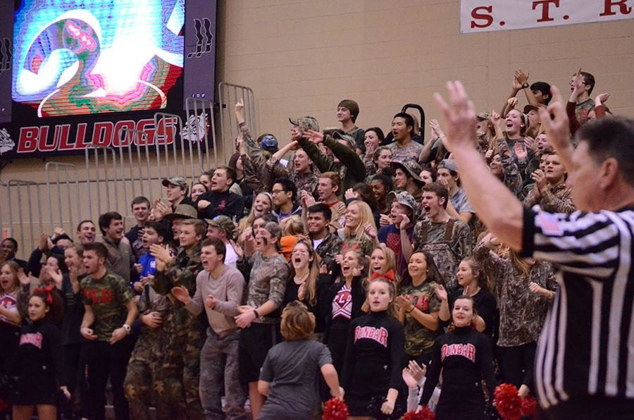 The student section celebrates after Dunbar scores.