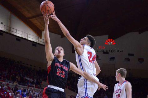 Senior Darius Williams grabs the rebound over Scott County