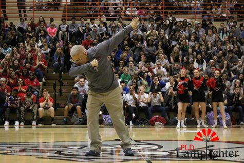 "Coach Scott Chalk ""hit the dab"" at the pep rally on Tuesday, Mar. 15"