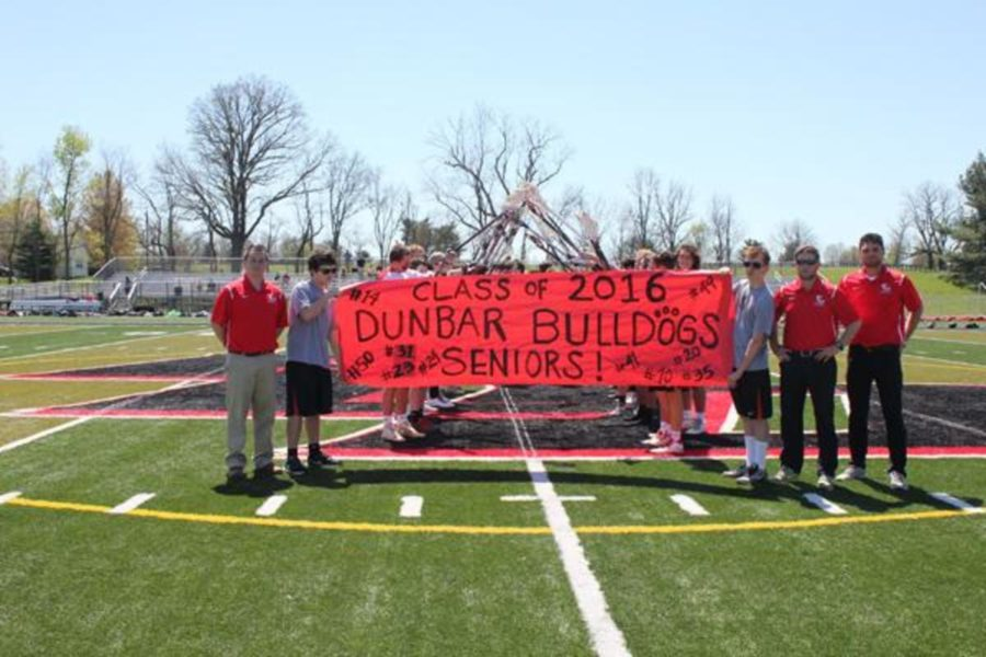 Dunbar's senior lacrosse players are welcomed onto the field.