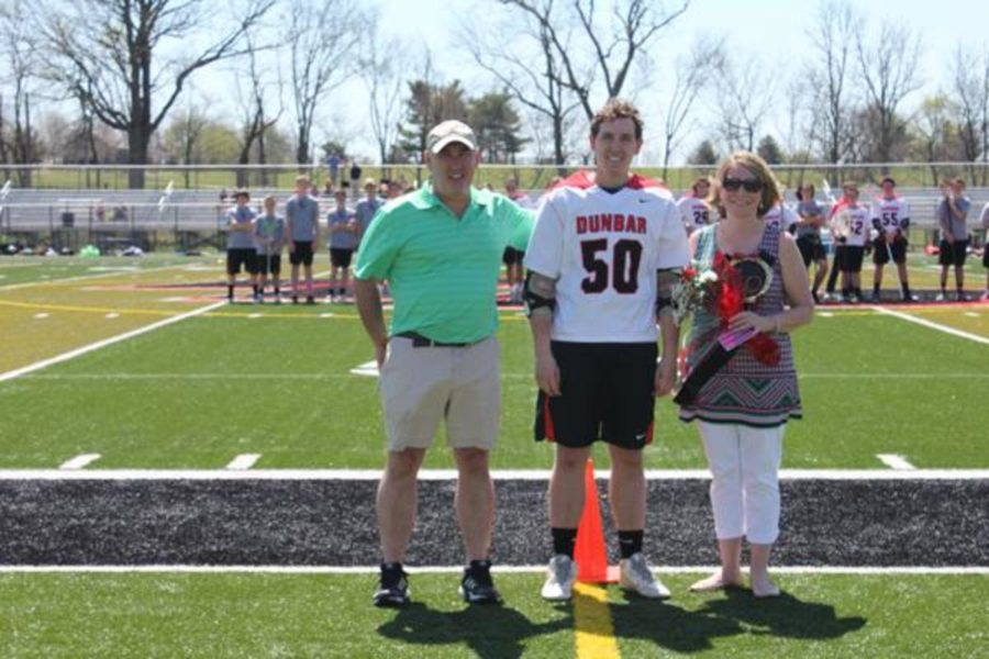 Senior Matthew Carter poses with his parents