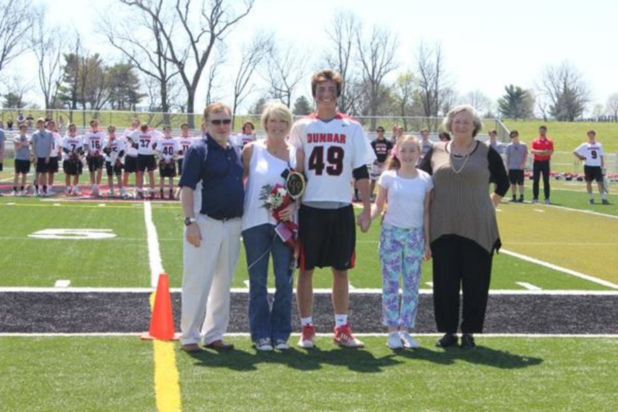 Senior Matthew Reynolds poses with his family