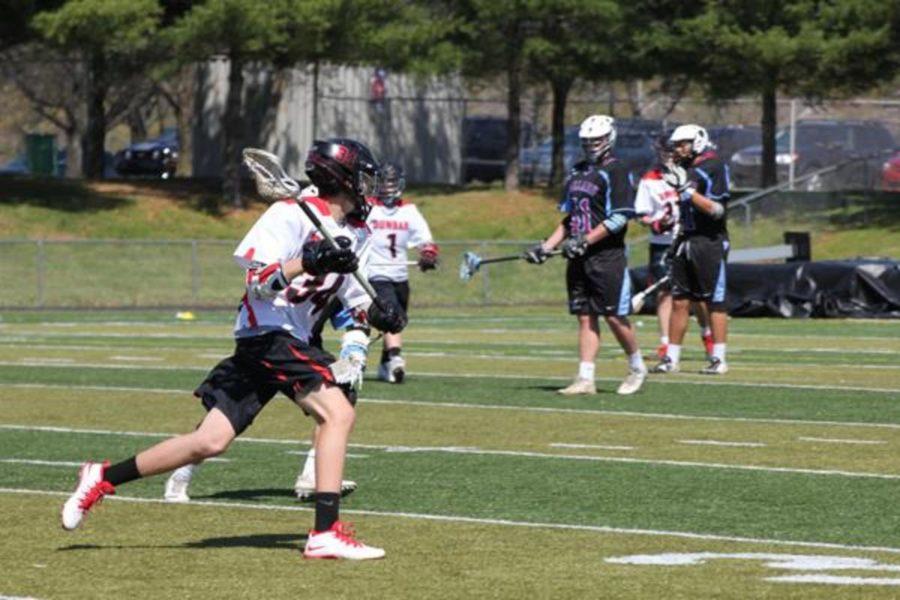 Freshman Drew Herald runs the ball.