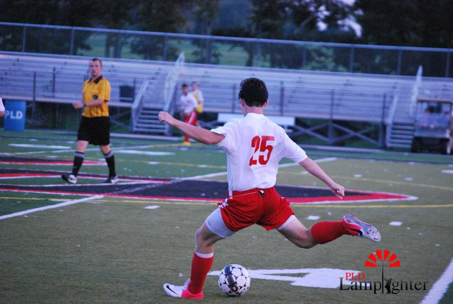#25 Jack Sheroan prepares for a powerful kick.