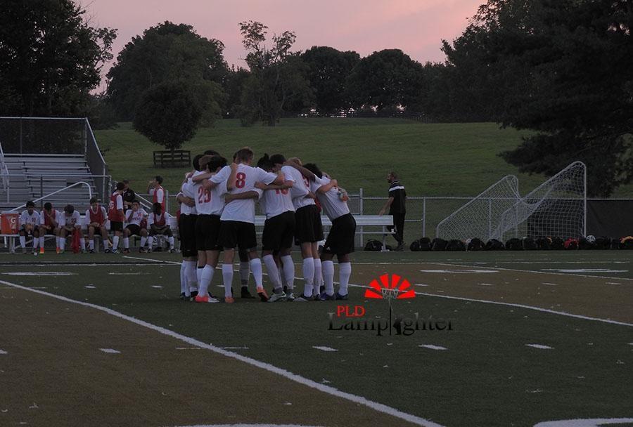 Boys soccer team huddles before the game against Bryan Station.