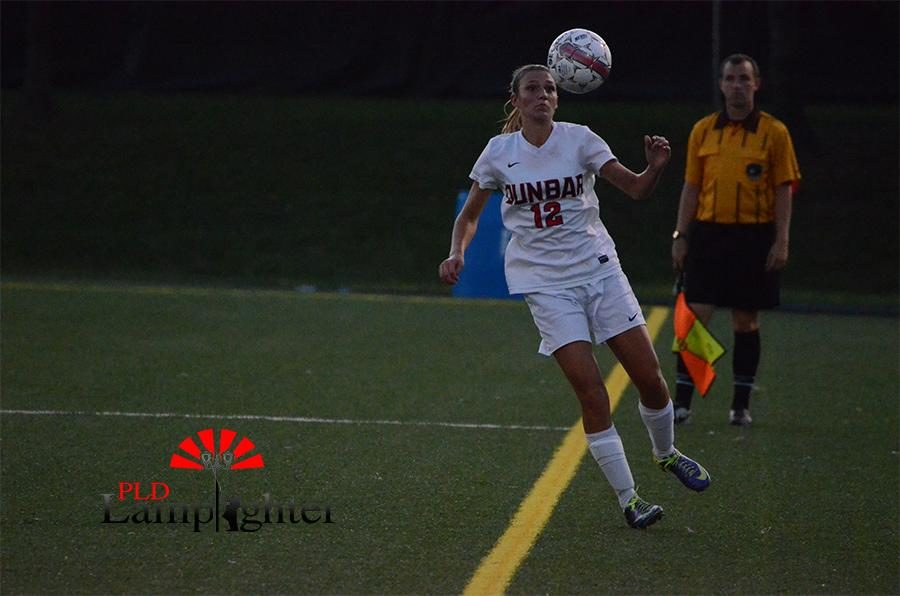 Baylee Lanter, #12 prepares to save the ball