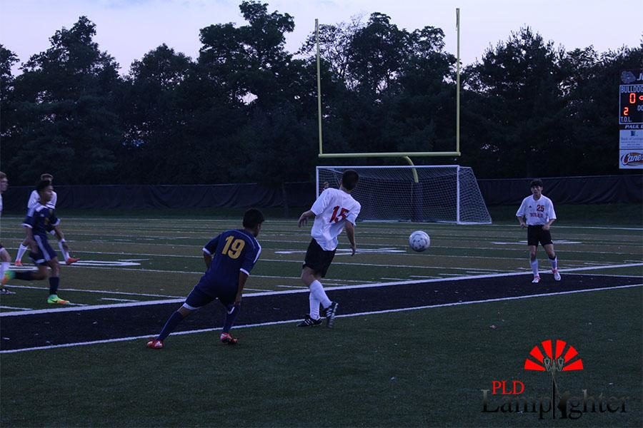 Jacob Gallt saves the ball from going out of bounce.
