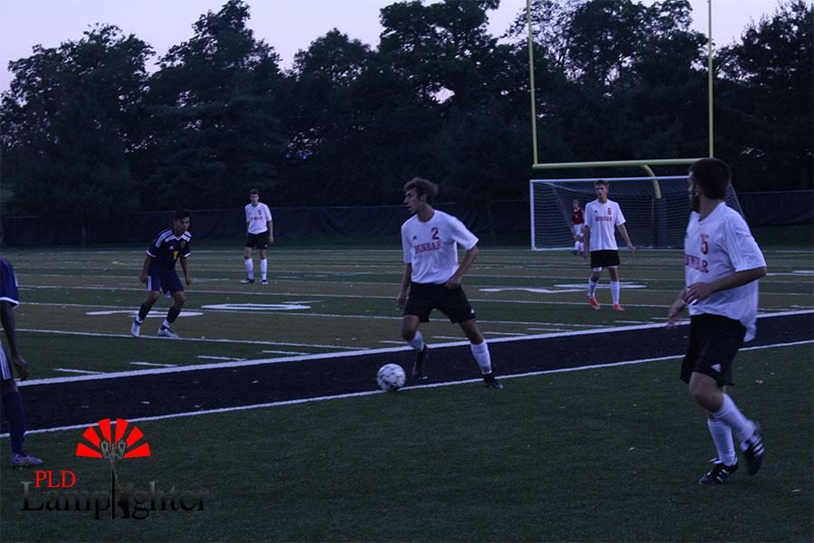 Harrison Grabmeyer works to navigate the ball around Bryan Station.