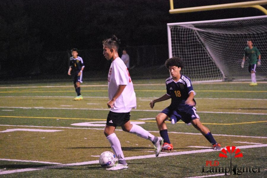 #19 Pedro Jaminiz tries to elude Bryan Station defender
