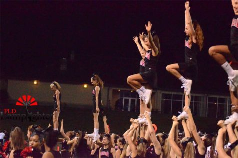 The cheerleaders practice libs on the sidelines of the Lafayette v Dunbar football game