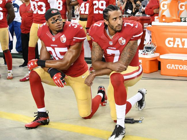 San Francisco Quarterback Colin Kaepernick and teammate Eric Reid kneel during the national anthem