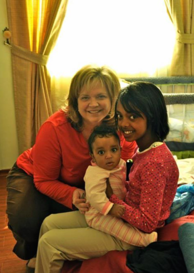Meron's mother, Kristin Roach, smiles before the girls leave Ethiopia for the first time with her.