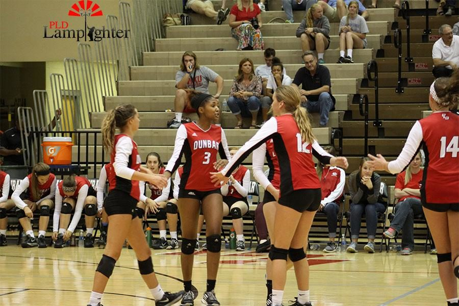 #5 Allie Chapman and #12 Meredith Phillips congratulate #3 Asia Henderson.