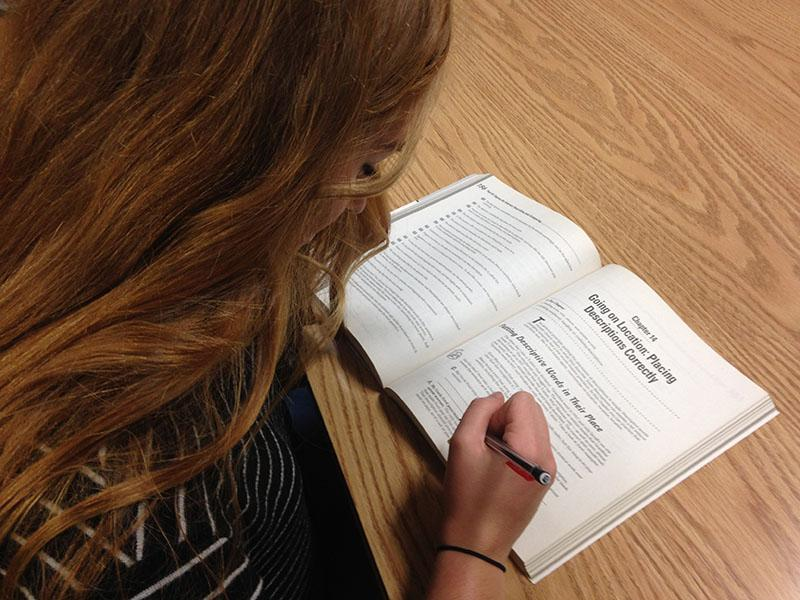 Broadcast editor, Maddie Carter studies hard for her next test.