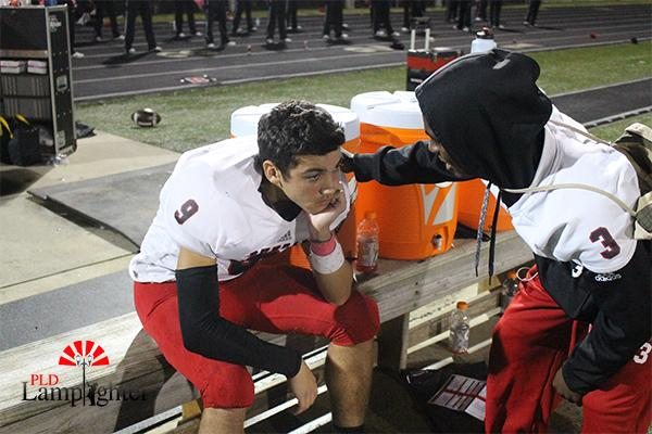 #3 Kaden Gaylord comforts his teammate, #9 Landon Jackson.
