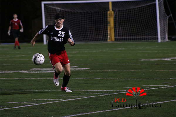 #25 Jack Sheroan kicks the ball.