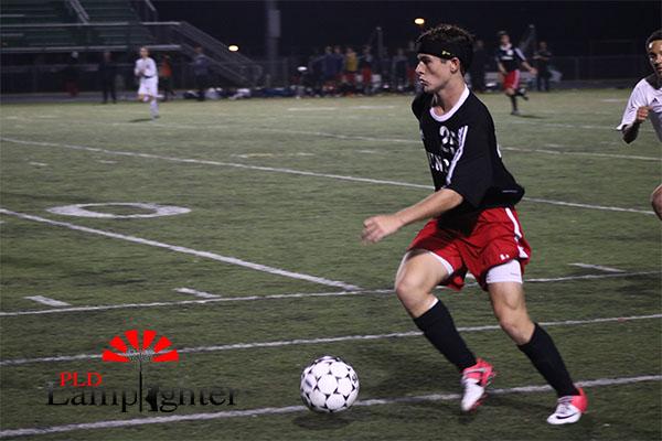 Jack Sheroan prepares to kick the ball.