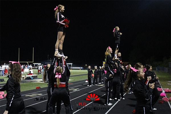 Cheerleaders stunt during the game.