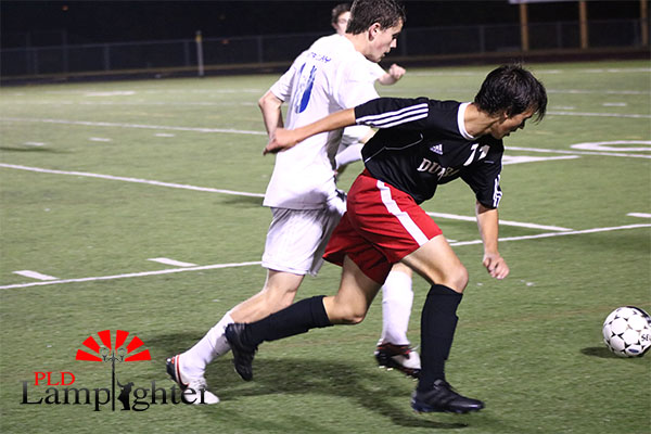 #11 Sullivan Curd chases the ball.