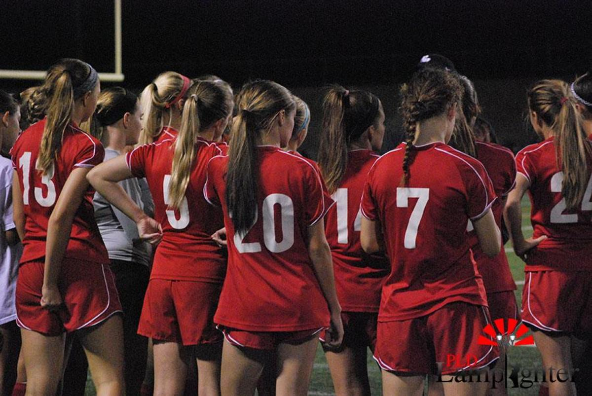 Dunbar Soccer girls have a group meeting after the first half.