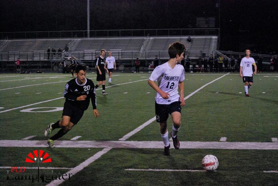 Dunbar Senior Javier Delagado goes for the ball.