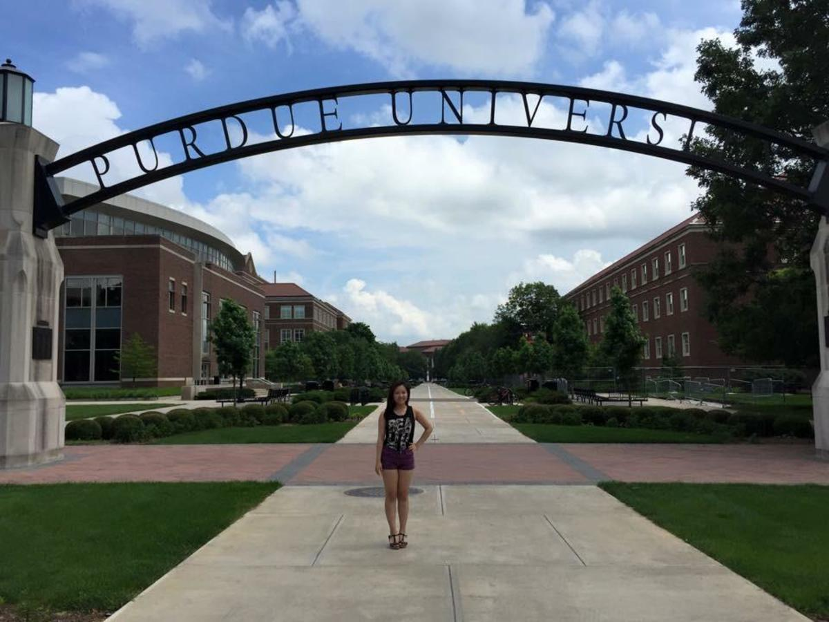 Senior Amy Wang poses in front of Purdue University