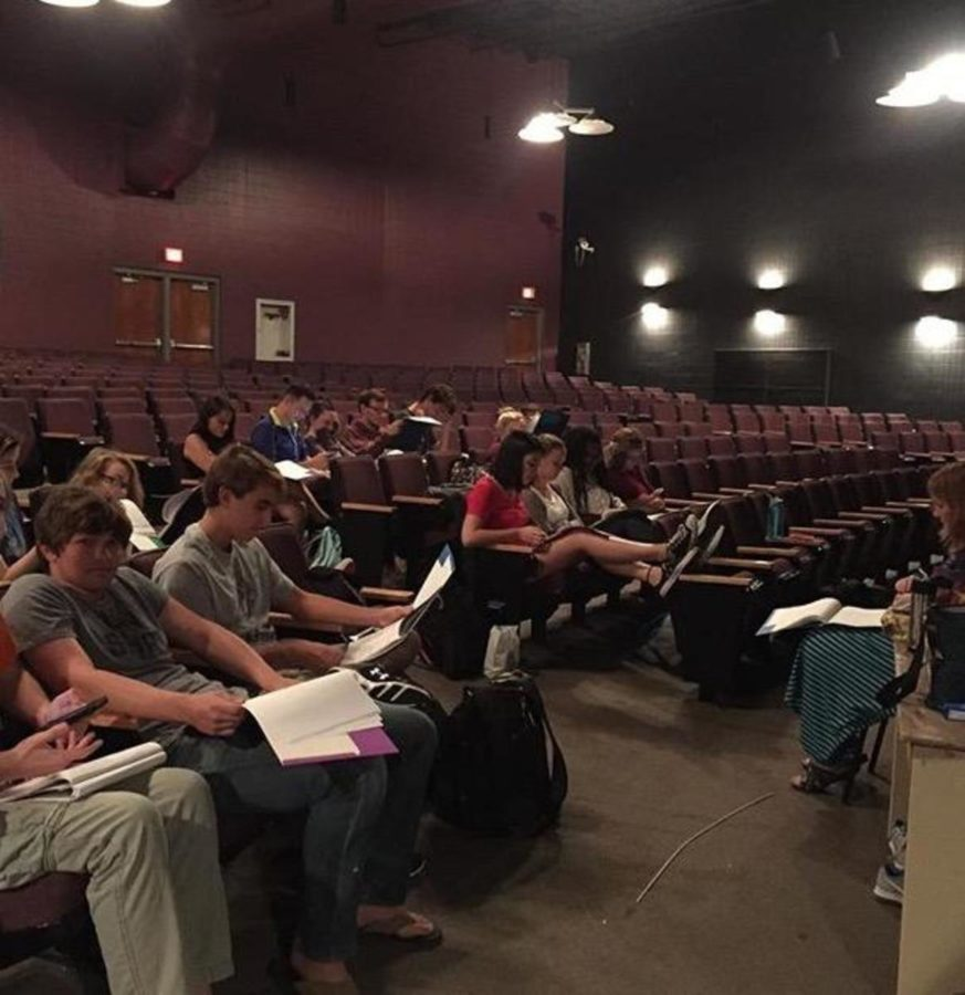 The cast of Monster prepares with a read-through in the theatre
