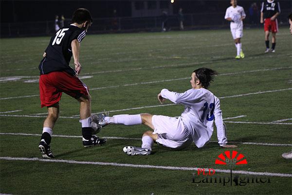 #15 Jacob Gallt steals the ball.