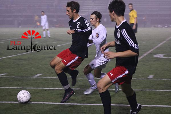 #2 Harrison Grabmeyer kicks the ball down the field.