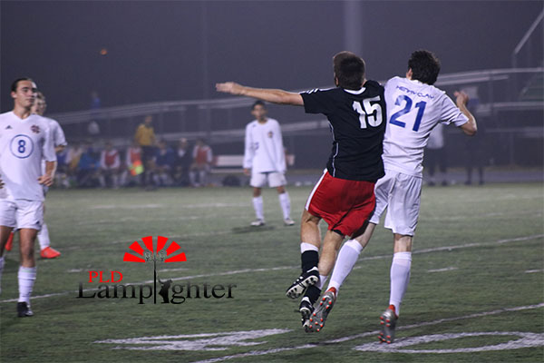 #15 Jacob Gallt collides with his opponenet.