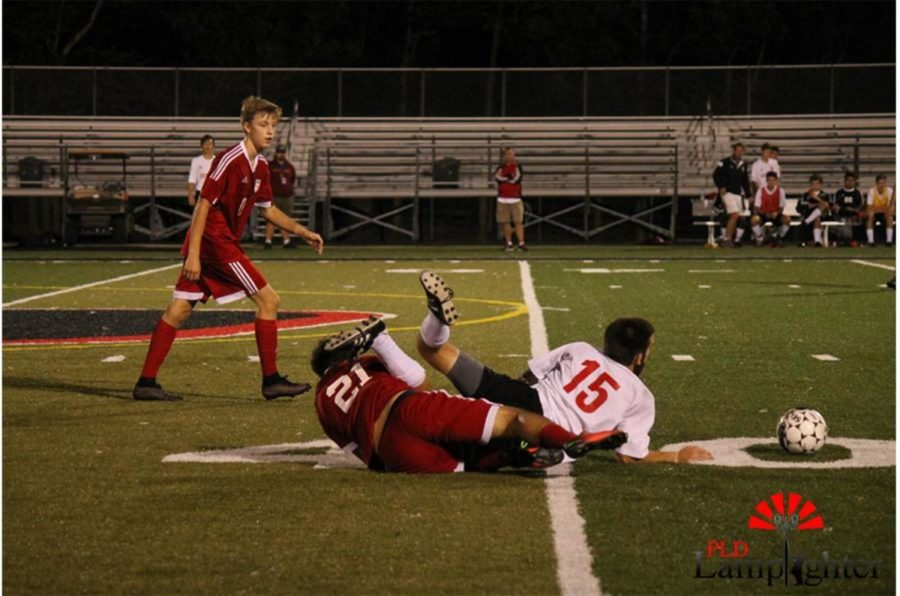 #15 Jacob Gallt and his opponent fight for the ball.