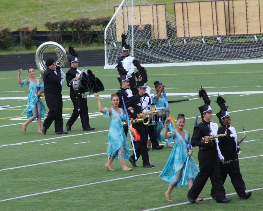 The band enters the field during their preshow performance